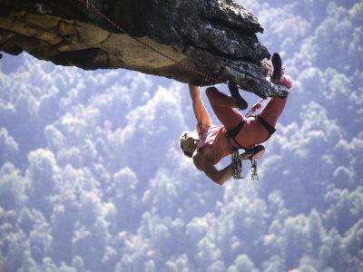 Climber on Edge of Rock, USA
