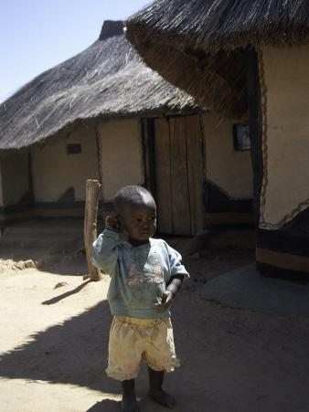 Child by Straw Hut, South Africa
