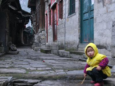 Child Playing on the Street, China