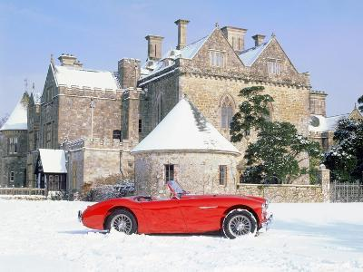 1956 Austin Healey 100M In Snow In Front Of Palace House, Beaulieu