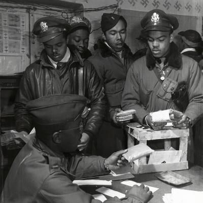 """Escape Kits"" (Cyanide) Being Distributed to Black Fighter Pilots at Air Base in Italy, 1945"