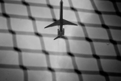 Airplane Through Fence B/W