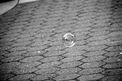 Bubble Floating Above Sidewalk