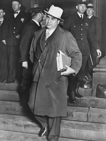Al Capone, Winks at Photographers as He Leaves Chicago's Federal Courthouse