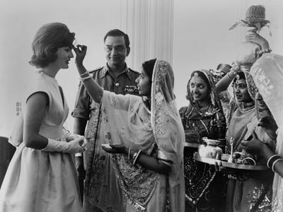 Jacqueline Kennedy Having a 'Bindi' Placed on Her Forehead at Jaipur, India