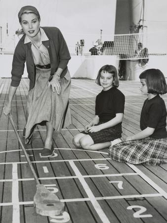 Grace Kelly by Playing Shuffleboard on the Deck of the Uss Constitution, April 10, 1956