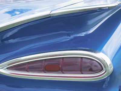 Tail Light on Blue Car