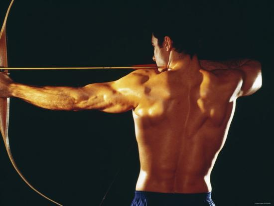 Strong Muscular Man Pulling Back on Bow and Arrow' Photographic ...