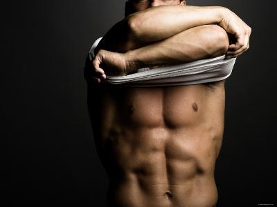 Sexy Muscular Man Taking Off Shirt