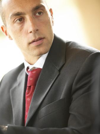 Listening Businessman Wearing Red Tie