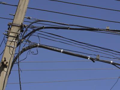 A Deep Blue Sky Behind Many Power Lines and a Telephone Pole