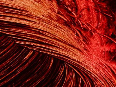 Close-up of Swirls of Bright Red Paint