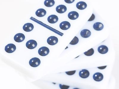 Pile of Black and White Dominoes Against White Background