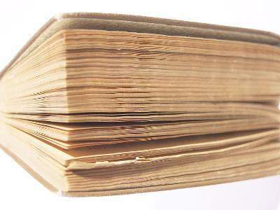 Close-up of Worn Hardcover Book with Yellowed Pages