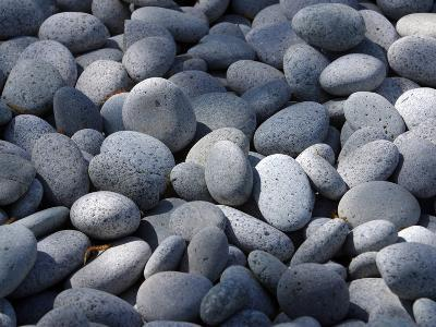 Close-up of a Pile of Smooth Rounded Gray Stones