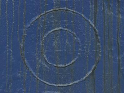A Blue Wooden and Weathered Wall with Circles