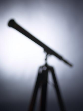 Blurred Silhouette of Telescope on Stand