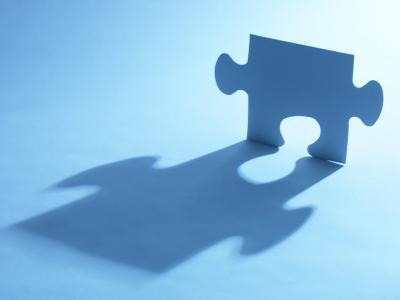 Standing Blue Puzzle Piece with Shadow in Blue Light