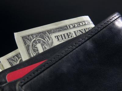American Dollar Bills in Black Weather Wallet