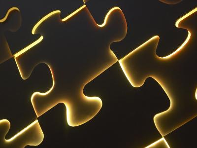 Black Puzzle with Yellow Light Shining Through the Cracks