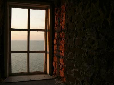 Sunlight Shining Through Window of Dark and Mysterious Room