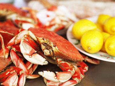 Fresh Crab and Lemons on Table