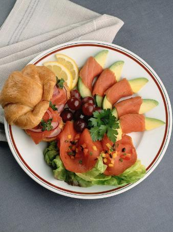 Plate with Meal of a Salmon Sandwich with Fruit