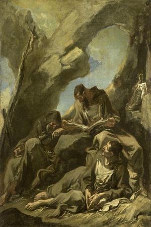Three Capuchin Monks Meditating in Prayer before a Crucifix in a Cave