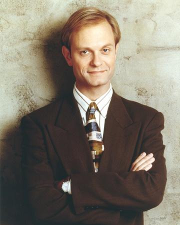 David Pierce Leaning on the Wall wearing Black Coat with Tie