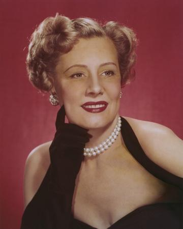 Irene Dunne wearing a Black Halter Dress with Pearl Necklace