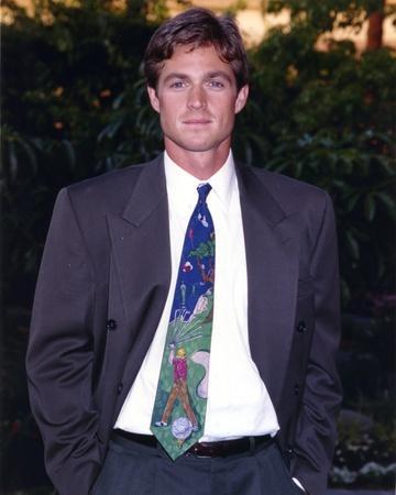 Eric Close Posed in Brown Tuxedo