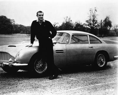 Goldfinger Bond Leaning on Car wearing Black Long Sleeves