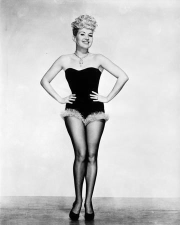 Betty Grable Posed with Hands Laid on the Waist in Black Strapless Tube Sexy Dress with Fur Bottom