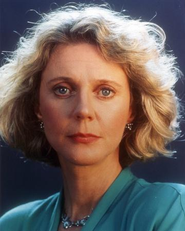 Blythe Danner wearing Blue Dress with Blue Background Close Up Portrait