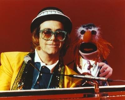 Elton John Playing Piano in Yellow Suit