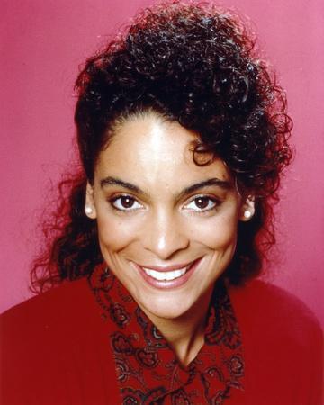 Jasmine Guy smiling in Red Coat