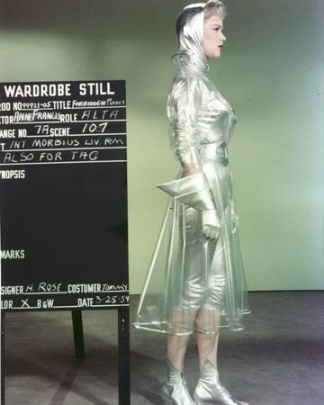 Anne Francis standing Facing Side View in Silver Glossy Dress