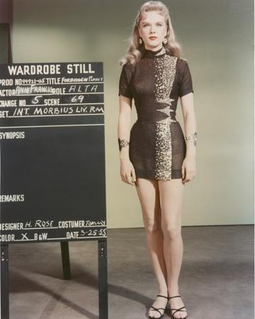 Anne Francis standing in Sexy Black Dress