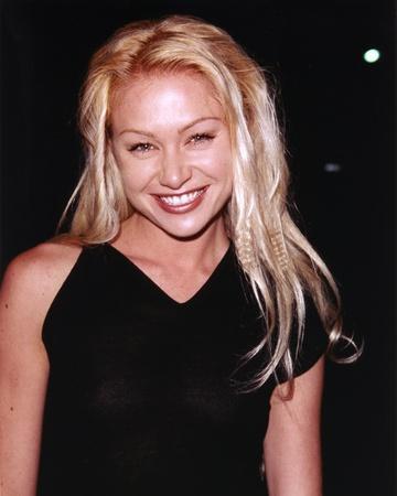 Portia Derossi smiling in Black Dress Portrait