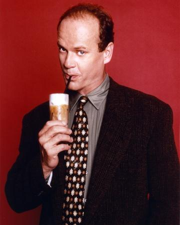 Kelsey Grammer Posed in a Suit and Tie with Red Background