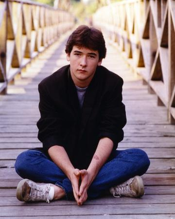 John Cusack sitting on the Bridge