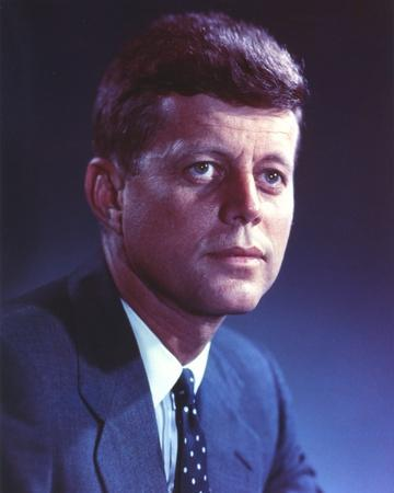 John Kennedy wearing a Blue Suit and a Polka Dot Necktie