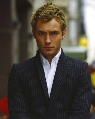 Jude Law Looking at the Camera wearing a Suit and White Undershirt in a Portrait