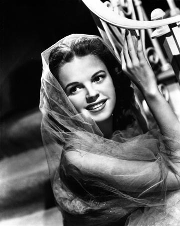 Judy Garland wearing a Cloak and Holding the Staircase in the Ziegfeld Girl 1941 Movie Scene