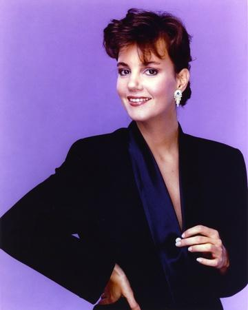 Margaret Colin smiling in Black Dress with Earrings