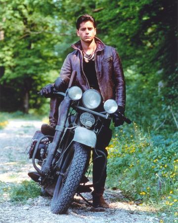 John Stamos posed Brown Jacket in a Motorcycle Portrait