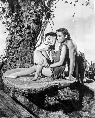 Johnny Weissmuller Making a Love Scene with a Woman in a Classic Movie Scene
