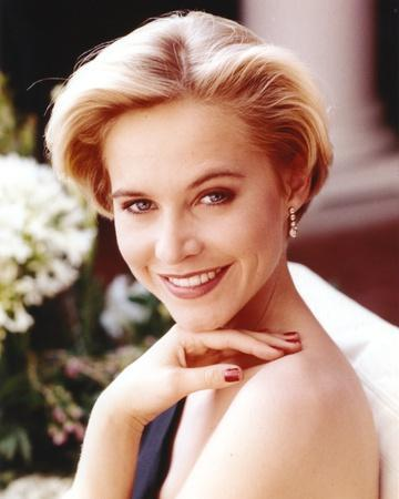 Josie Bissett Showing Her Smile and Her Earrings in a Portrait