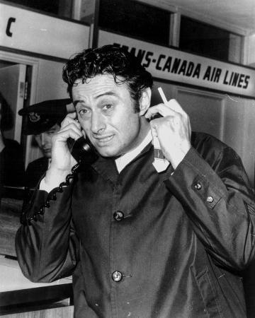 Lenny Bruce Answering Telephone in Black Tuxedo