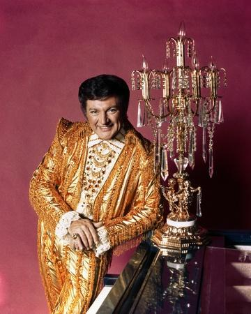 Liberace posed in Yellow Sparkling Suit